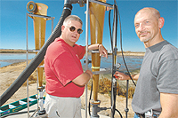 Ron Sheffield, left, and Keith Bowers are working on technology that takes dissolved phosphorus out of dairy lagoon wastewater.