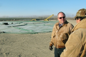 (Dean Brickey) Marty Myers, left, general manager at Threemile Canyon Farms, talks with employee Tom Chavez about the operation of the new methane digester, which is expected to reduce the farm's natural gas use.