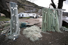 (Andy Sawyer) Gill nets hang like a curtain in front of the concrete slab that was once the home of Celilo Chief Tommy Thompson.