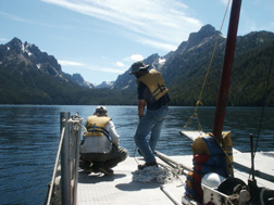 Researchers on Redfish Lake in process of taking sample. (Photo by Jason Addison provided by Mark Shapley)