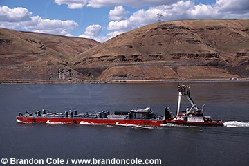 (Brandon Cole photo) Barge on Snake river transporting juvenile salmon.