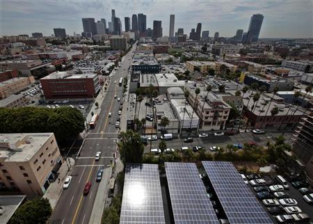 (photo: Lucy Nicholson) Solar panels are seen in the parking lot of 1929 building Walter J Towers, near downtown Los Angeles.