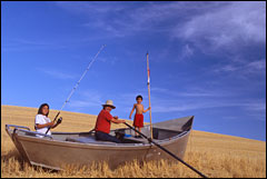 (Photo:  Steve Pettit) Nez Perce fisher James Walker with daughter Alana and son Teewis in a sea of wheat.