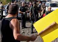 (Don Ryan/Associated Press) Longshoremen in Longview, Wash., faced off with police in a rare showing of union militancy.